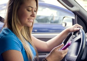 15862-a-teen-girl-texting-while-driving-pv